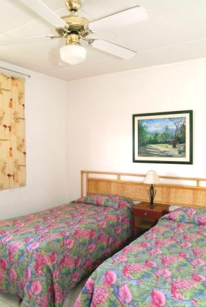 A twin bedroom at the Adulo